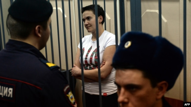 Detained Ukrainian pilot Nadia Savchenko stands inside the defendant's cage during her hearing in a Moscow court on November 11, 2014.