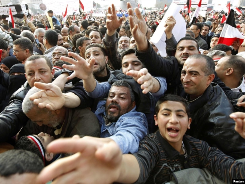Protesters scramble for food and drink being distributed during mass demonstrations at Cairo's Tahrir Square in early February. Photo: Reuters/RFERL
