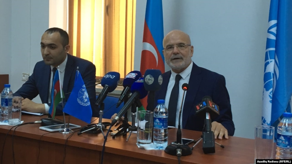 Michel Forst (right), the UN special rapporteur on the situation of human rights defenders, addressing reporters in Baku on September 22.