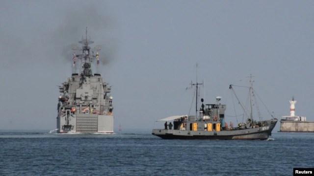 "The Russian amphibious landing vessel ""Caesar Kunikov"" (left) leaves the Black Sea port of Sevastopol in 2012."