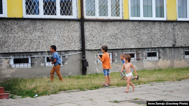 Children play outside an asylum-seekers' center in Bialystok.