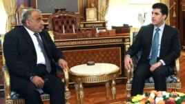 Oil Minister Adel Abdul-Mahdi in Erbil with the head of Iraq's Kurdistan Regional Government, Barzani