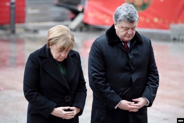 Ukrainian President Petro Poroshenko (right) cut short a visit with German Chancellor Angela Merkel to deal with the crisis in the east.