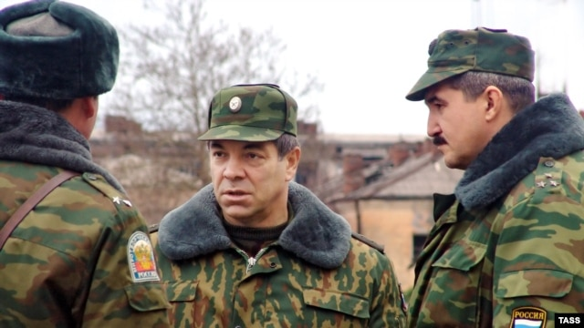 Major General Sergei Kuzovlev (right) goes by the pseudonyms