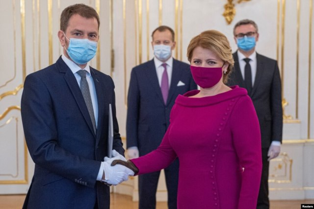Slovak President Zuzana Caputova wore a fuchsia-colored face mask that matched her outfit when she welcomed Prime Minister Igor Matovic at his cabinet's inauguration in Bratislava on March 21.