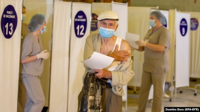 A man leaves a vaccination point after receiving a dose of Russia's Sputnik V vaccine in Chisinau on June 21.