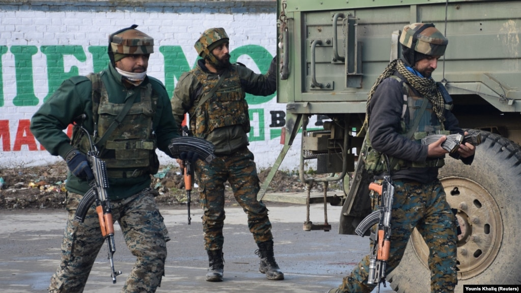 Indian Army soldiers arrive near the site of a gunbattle between suspected militants and Indian security forces in Kashmir's Pulwama district on February 18.