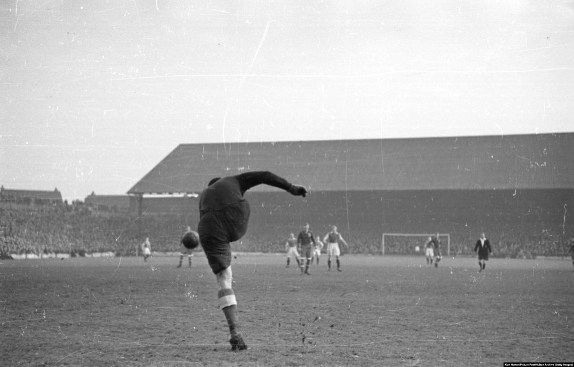Dynamo Moscow goalkeeper Aleksei Khomich kicks the ball up-field at Cardiff City's Ninian Park ground during his team's British tour. Cardiff lost 10-1.