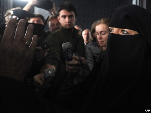 Sandrine Moulleres (R) was fined by French authorities in Nantes in April for driving in a full-face veil.