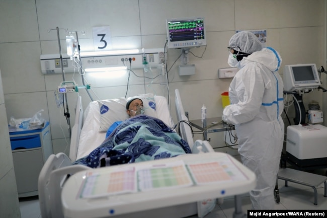 A patient being treated for coronavirus at a hospital in Tehran.