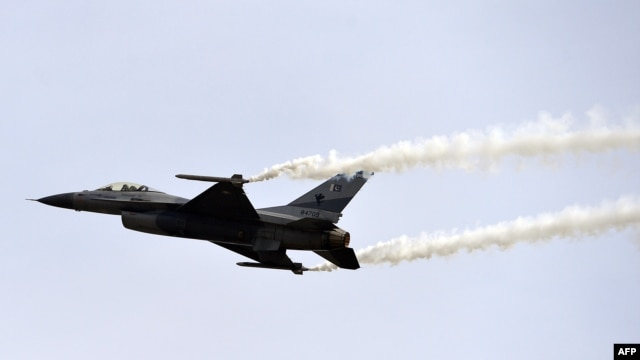 A Pakistani F-16 fighter performs a flypast during the Pakistan Day military parade in Islamabad on March 23.