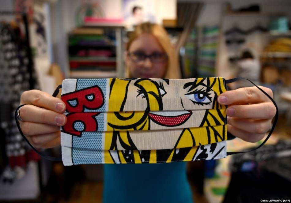 A woman presents a protective face mask designed by Croatian designer Zoran Aragovic, who designed a cotton mask in his distinctive pop-art style, in Zagreb on March 3.