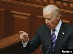 """Then-U.S. Vice President Joe Biden addressed deputies at the parliament in Kyiv on December 8, 2015. """"You...have a battle, a historic battle against corruption,"""" he scolded them. """"Ukraine cannot afford for the people to lose hope again."""""""