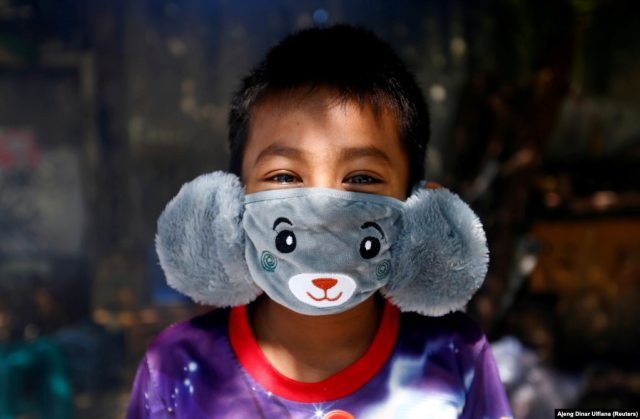 Panji, 8, wears an animal-shaped face mask to help prevent the spread of the coronavirus in Jakarta, Indonesia, on April 2.