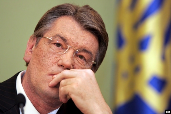 Former President Viktor Yushchenko, his face disfigured by dioxin poisoning, in 2006