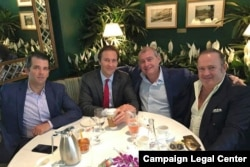 A Facebook screen shot provided by the Campaign Legal Center shows from left to right: Donald Trump Jr, Tommy Hicks Jr, Lev Parnas, and Igor Fruman in May 2018.