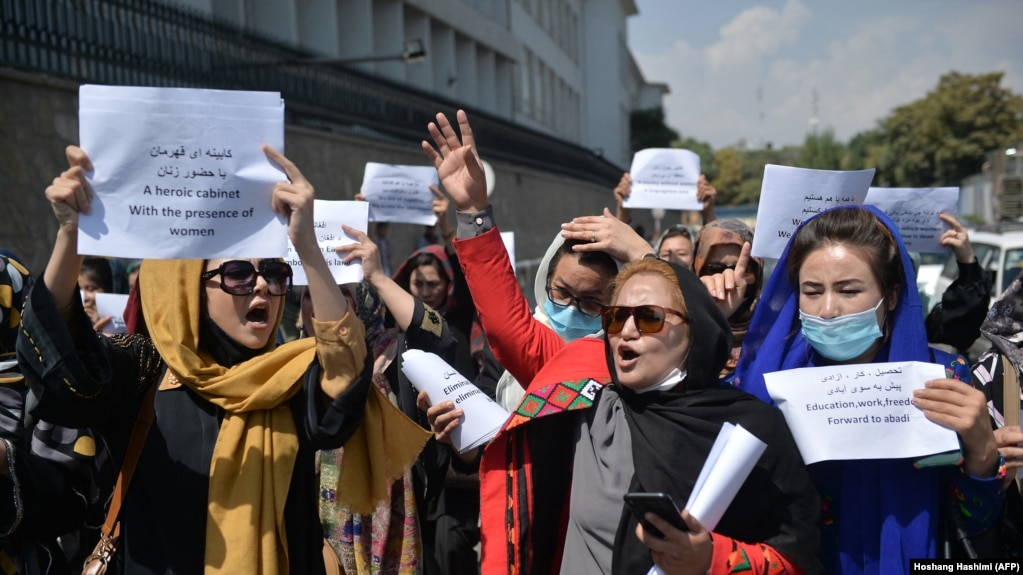Afghan women take part in a protest march for their rights under the Taliban rule in the downtown area of Kabul on September 3.