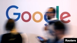 FILE - The logo of Google is pictured during the Viva Tech startup and technology summit in Paris, France, May 25, 2018.