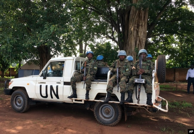 FILE - United Nations Peacekeepers drive in a truck in Yei, South Sudan, July 13, 2017.