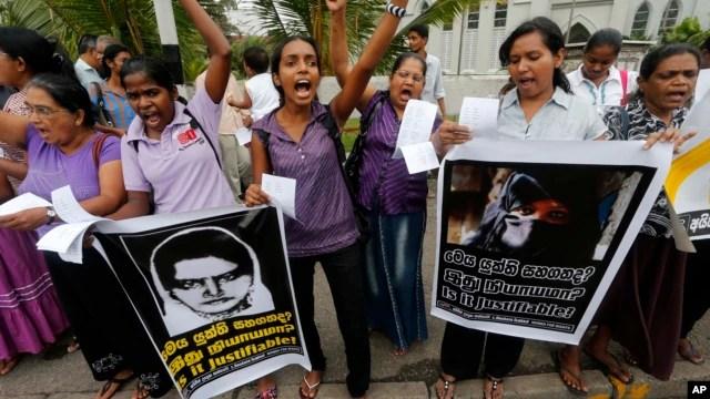 Sri Lankan women protest in Colombo, Sri Lanka, Jan. 11, 2013, condemning the execution of Sri Lankan domestic worker Rizana Nafeek in Saudi Arabia