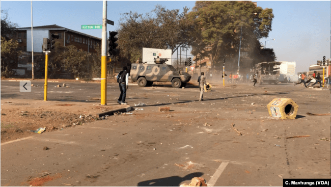 FILE - The international community and human rights groups have condemned the way President Emmerson Mnangagwa's government used the army to disperse opposition protesters demanding the release of credible election results. At least six people were killed in the protests in Harare, Aug. 1, 2018.