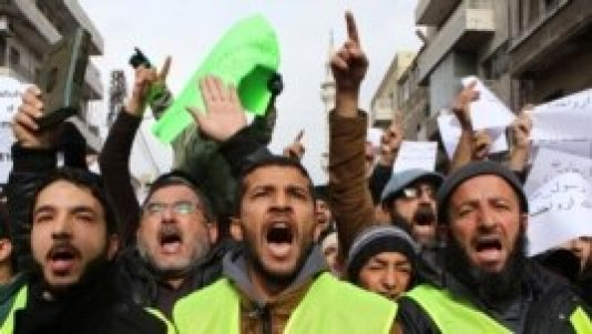 Jordanians chant slogans during a protest against cartoons depicting the Prophet Muhammad in the French magazine Charlie Hebdo, after Friday prayers in Amman, Jan. 16, 2015.