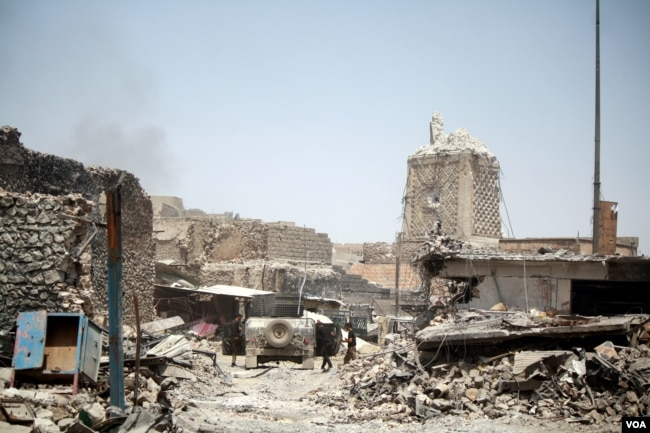 The al-Nuri Mosque, the symbolic heart of IS was bombed by militants in June, and is now in the hands of Iraqi forces, prompting the declaration of victory in Mosul. (H.Murdock)