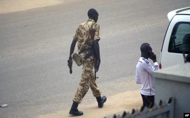 FILE - A South Sudan soldier patrols the street in Juba, South Sudan, July 11, 2016.