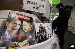 FILE - A magazine with caricatures of then-U.S. President Barack Obama and North Korean leader Kim Jong Un is displayed at a book store in Seoul, South Korea, Jan. 3, 2015. The United States imposed new sanctions at the time on North Korean government officials and the country's defense industry for a cyberattack against Sony, insisting that Pyongyang was to blame.