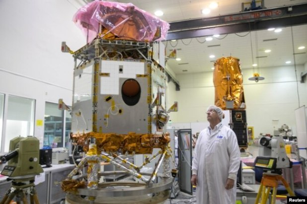 Ofer Doron, head of the Space Division of state-owned Israel Aerospace Industries, the country's biggest defence contractor, looks at a satellite in a clean room at Yahud, Israel Feb. 27, 2017.