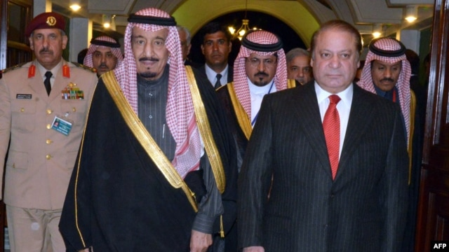 A handout photo released by the Press Information Department (PID) shows Pakistani Prime Minister Muhammad Nawaz Sharif (R) welcoming Saudi Crown Prince Salman bin Abdul Aziz Al- Saud at the Prime Minister's House in Islamabad. Feb. 17, 2014 (AFP)