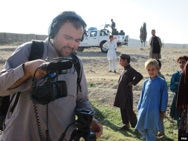 Boys observe as VOA cameraman Rahim Gul Sarwan prepares to shoot video in Achin district in eastern Afghanistan.