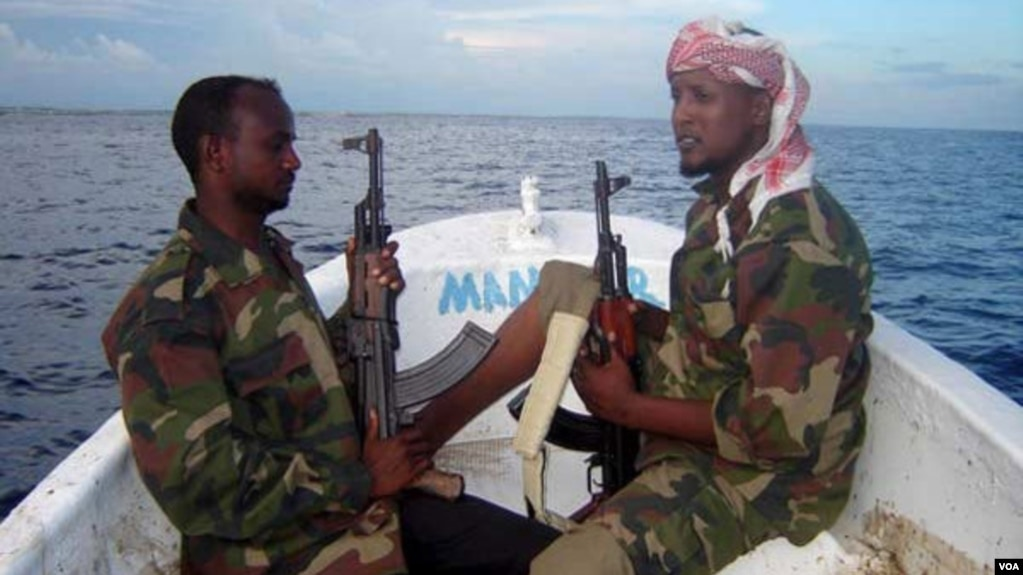 FILE - Somali pirates are shown in February 2012.