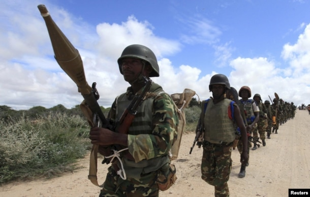 FILE - African Union Mission in Somalia (AMISOM) peacekeepers from Burundi patrol after fighting between insurgents and government soldiers erupted on the outskirts of Mogadishu.