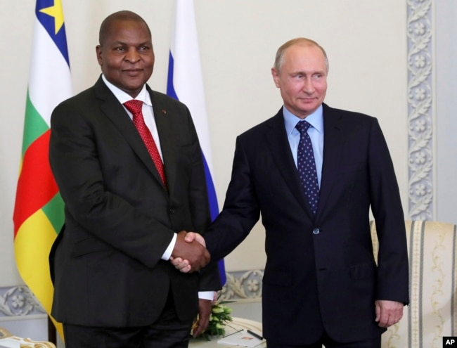 Russian President Vladimir Putin, right, shakes hands with Central African Republic President Faustin-Archange Touadéra, in St. Petersburg, Russia, Wednesday, May 23, 2018.