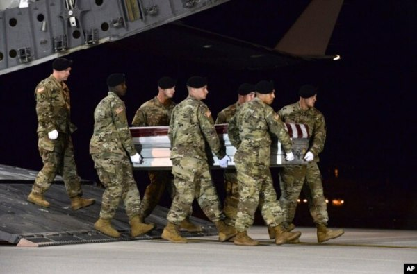 In this image provided by the U.S. Air Force, a U.S. Army carry team transfers the remains of Army Staff Sgt. Dustin Wright of Lyons, Georgia, Oct. 5, 2017, upon arrival at Dover Air Force Base, Delware.