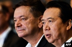 FILE - Interpol vice president Alexander Prokopchuk (L) and Meng Hongwei, then-president of Interpol, are seen at the opening of the Interpol World Congress, in Singapore, July 4, 2017.