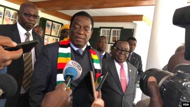 President Emmerson Mnangagwa speaks to reporters in Harare, Zimbabwe, July 20, 2018. Mnangagwa says the Zimbabwe Electoral Commission is independent and professional to run a credible election on July 30. (S. Mhofu/VOA)