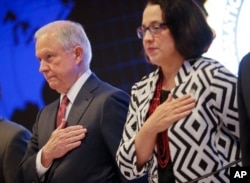 U.S. Attorney General Jeff Sessions and U.S. Ambassador to El Salvador Jean Elizabeth Manes stand during the playing of the U.S. national anthem during a graduation ceremony at the International Law Enforcement Academy in San Salvador, El Salvador, July 2, 2017.