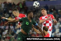Croatia and Nigeria go head to head in a June 16 game that Croatia wins 2-0. Croatia's bold, checkered 'home' jerseys skip the subtlety of their 'away' uniforms. (Reuters)
