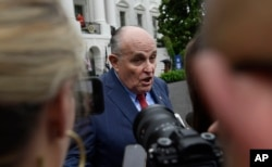 FILE - President Donald Trump's lawyer Rudy Giuliani speaks to reporters on the South Lawn of the White House in Washington, May 30, 2018.