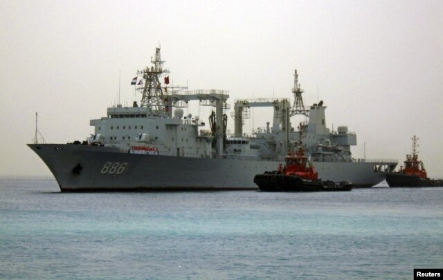 FILE - Chinese navy warships arrive at the seaport of Port Sudan.