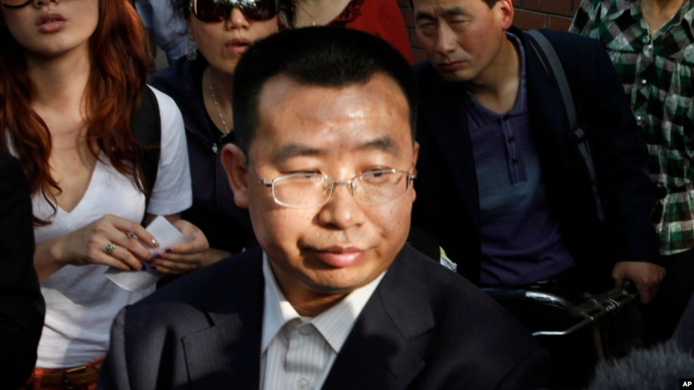 FILE - Human rights activist Jiang Tianyong speaks to journalists outside a hospital after his failed attempt to see blind Chinese activist Chen Guangcheng who is believed to be seeking treatment in Beijing, China, May 2, 2012. The wife of one of China's most prominent human rights campaigners says he has disappeared during a trip to visit relatives of a detained rights lawyer.