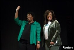 FILE - Oprah Winfrey takes part in a town hall meeting with Democratic gubernatorial candidate Stacey Abrams ahead of the midterm election in Marietta, Georgia, Nov. 1, 2018.