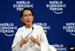 FILE - Aung San Suu Kyi, Myanmar's civilian leader, speaks at the World Economic Forum's meeting at the National Convention Center in Hanoi, Vietnam, Sept. 13, 2018.