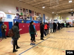 Voters in Arlington, Virginia, stand in line waiting to exercise their constitutional right to vote. November 6 of 2018.