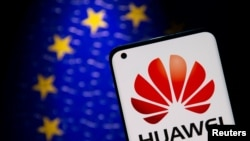 Smartphone with a Huawei logo is seen in front of an E.U. flag in this illustration taken Sept. 28, 2021.