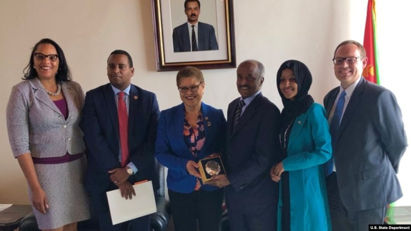 Chief of Mission Natalie E. Brown, far left, and Deputy Chief of Mission Stephen Bank, far right, pose with Rep. Joe Neguse, Rep. Karen Bass, Eritrean Minister of Foreign Affairs Osman Saleh and Rep. Ilhan Omar. The members of Congress were on an official visit to Eritrea.