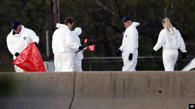 Autoridades investigan el lugar donde se suicidó el sospechoso de varios ataques con bomba en Austin, Texas .Marzo 21, de 2018.