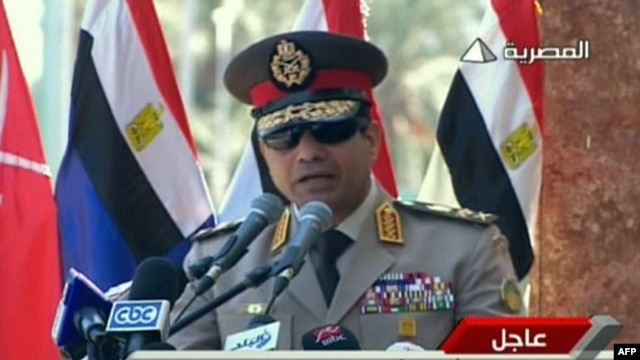 """FILE - An image grab taken from Egyptian state TV shows Egypt's army chief General Abdel Fattah al-Sisi giving a live broadcast calling for public rallies  to give him a mandate to fight """"terrorism and violence."""""""